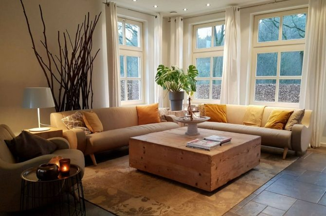 Dorpswoning Het Uitzicht - Villapparte - luxe vakantiehuis voor 14 personen - groepsaccommodatie - Noord Brabant - zithoek woonkamer