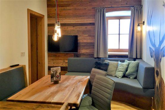 MandlWand Lodge - Villapparte - 9 luxe appartementen met Sauna Welness - Salzburgerland - Oostenrijk - zitkamer