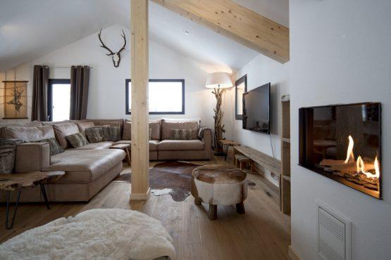 Villapparte-Belvilla-Chalet Reiteralm-luxe chalet voor 8 personen in Schladming-Oostenrijk-zithoek met openhaard