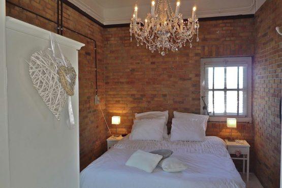 Villapparte-Belvilla-Vakantiehuis de Kustwachttoren in Huisduinen-unieke vakantielocatie voor 2 personen-romantische slaapkamer