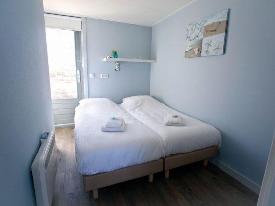 Villapparte-Strandhuisje Julianadorp-Direct op het strand-voor 4 personen-Noord-Holland-knusse slaapkamer