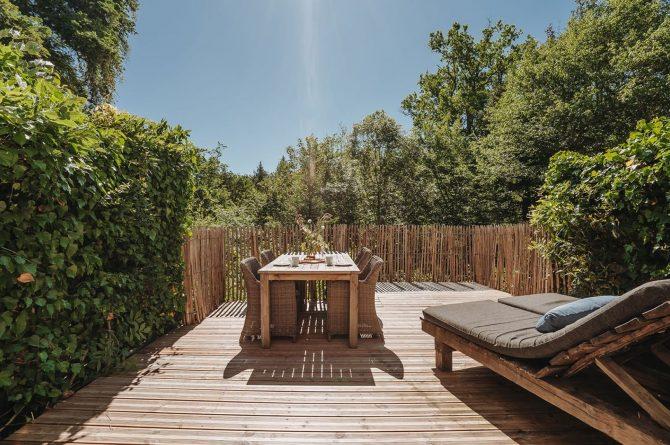 Villapparte-La Bastide - een kleinschalig vakantiedomein met 8 vakantiehuizen in de Haute Vienne met 2 zwembaden-terras vakantiehuis Normandie