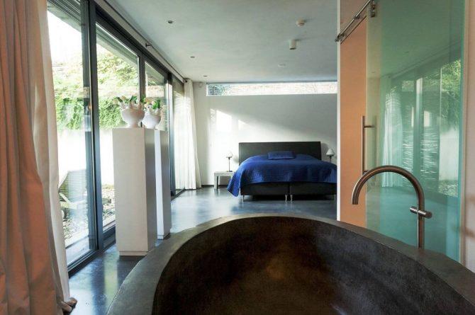 Villapparte-Special Villas-Vakantiehuis Betonnen Boshuis-luxe vakantiehuis voor 4 personen-Oosterhout-Noord-Brabant-luxe slaapkamer