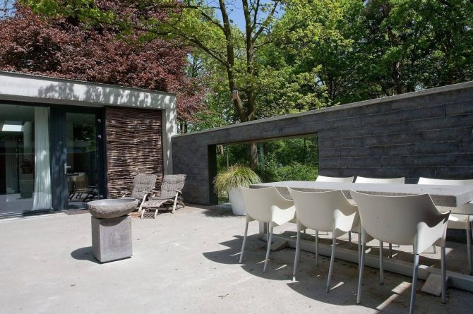 Villapparte-Special Villas-Vakantiehuis Betonnen Boshuis-luxe vakantiehuis voor 4 personen-Oosterhout-Noord-Brabant-zonnig terras