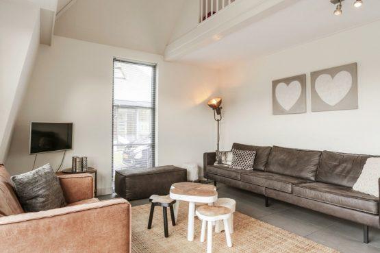 Villapparte-Villa Weideduyn 10-luxe vakantiehuis voor 6 personen met sauna en jacuzzi-Schoorl-Noord-Holland-knusse zithoek