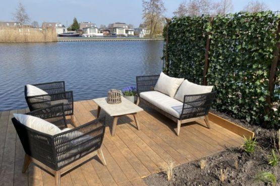 Villapparte-Natuurhuisje-Vakantiehuis Scheendijk-romantisch vakantiehuis voor 4 personen-Breukelen-loungeset aan het water