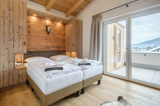 Villapparte-Villa for You - Penthouse Kreischberg - luxe penthouse voor 8 personen-met Sauna-St. Lorenzen ob Mureau-Oostenrijk-slaapkamer met schuifpui