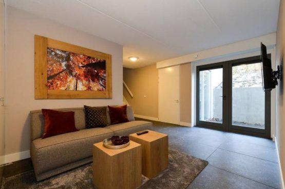 Villapparte- Natuurhuisje Vrijrijck-Ermelo-luxe vakantiehuis voor 16 personen-Gelderland-knusse zithoek